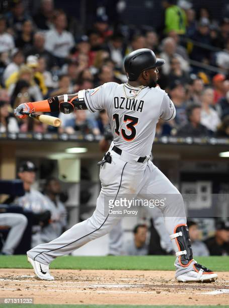 Marcell Ozuna of the Miami Marlins hits a solo home run during the second inning of a baseball game against the San Diego Padres at PETCO Park on...