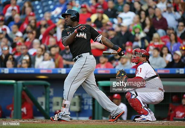 Marcell Ozuna of the Miami Marlins hits a solo home run in the second inning during a game against the Philadelphia Phillies at Citizens Bank Park on...