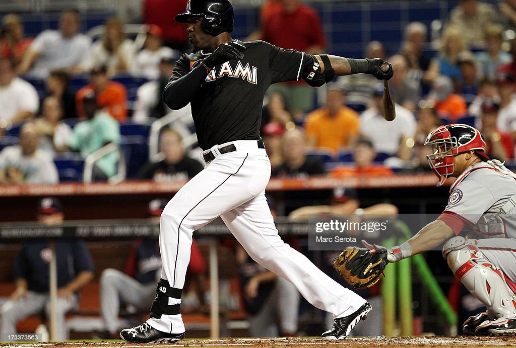 Marcell Ozuna #48 of the Miami Marlins hits a three-run triple against the Washington Nationals during the first inning at Marlins Park on July 12, 2013 in Miami, Florida.