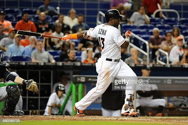 Marcell Ozuna of the Miami Marlins hits an RBI single during the 3rd inning of the game between the Miami Marlins and the Milwaukee Brewers at...