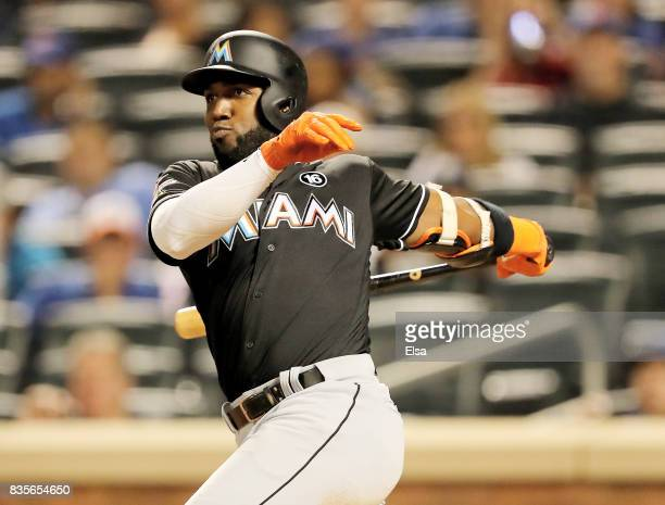 Marcell Ozuna of the Miami Marlins hits an RBI single in the sixth inning against the New York Mets on August 19 2017 at Citi Field in the Flushing...
