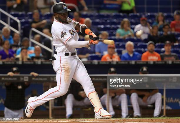 Marcell Ozuna of the Miami Marlins hits during a game against the Cincinnati Reds at Marlins Park on July 27 2017 in Miami Florida