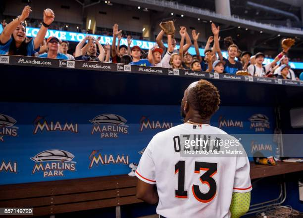 Marcell Ozuna of the Miami Marlins interacts with fans after the game against the Atlanta Braves at Marlins Park on October 1 2017 in Miami Florida