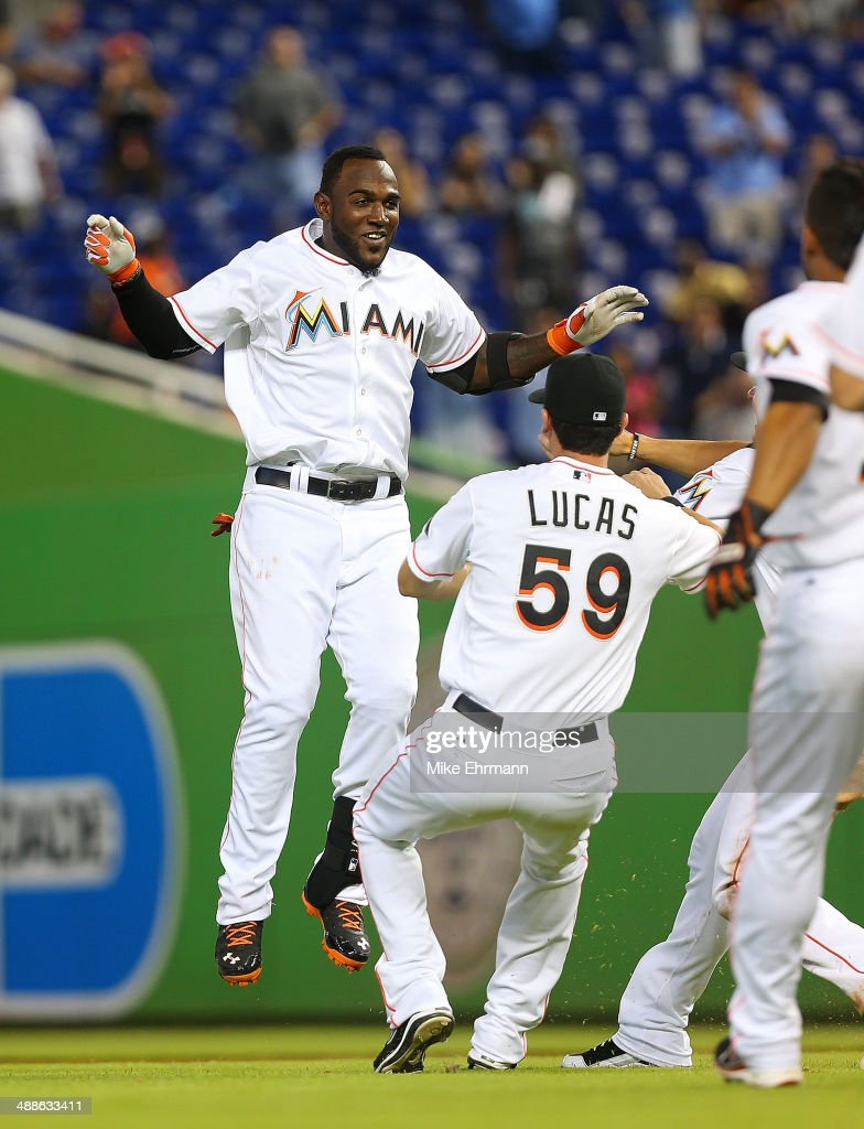 <a gi-track='captionPersonalityLinkClicked' href=/galleries/search?phrase=Marcell+Ozuna&family=editorial&specificpeople=10358366 ng-click='$event.stopPropagation()'>Marcell Ozuna</a> #13 of the Miami Marlins is congratulated after hitting a walk off sacrafice fly during a game against the New York Mets at Marlins Park on May 7, 2014 in Miami, Florida.