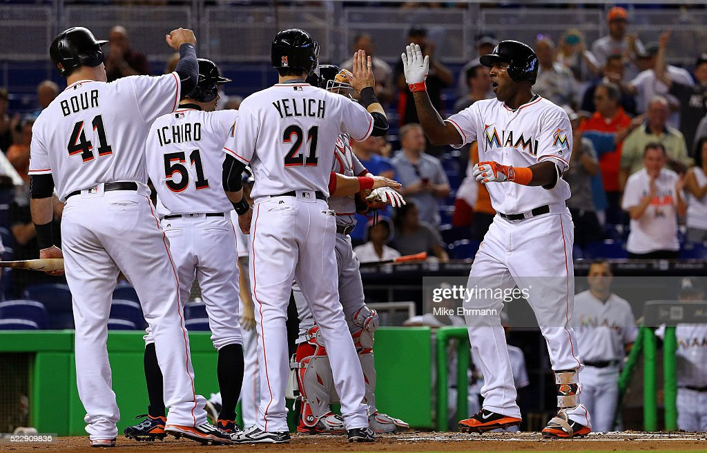 <a gi-track='captionPersonalityLinkClicked' href=/galleries/search?phrase=Marcell+Ozuna&family=editorial&specificpeople=10358366 ng-click='$event.stopPropagation()'>Marcell Ozuna</a> #13 of the Miami Marlins is congratulated after hitting a three run home run in the first inning during a game against the Washington Nationals at Marlins Park on April 21, 2016 in Miami, Florida.