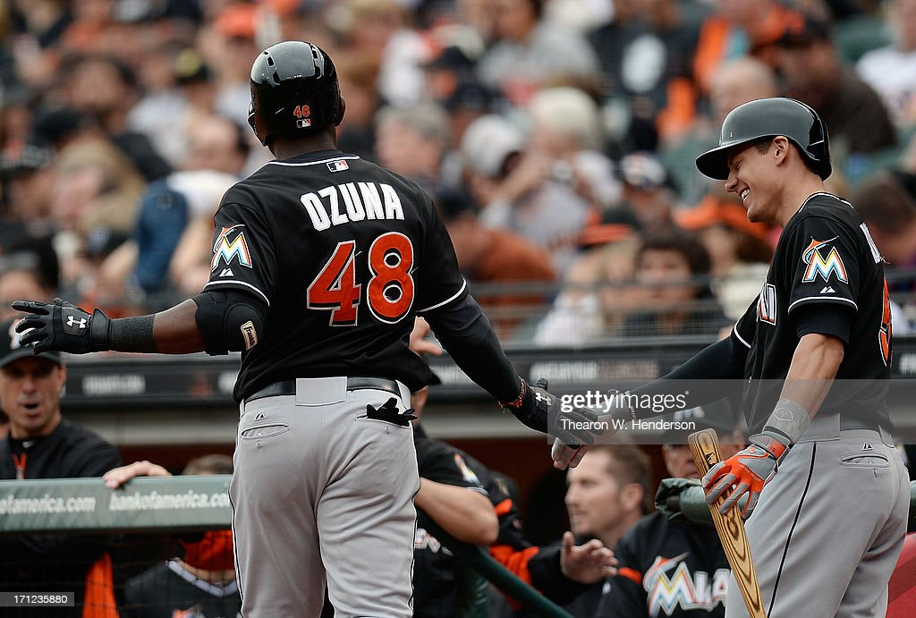 Marcell Ozuna #48 of the Miami Marlins is congratulated by Derek Dietrich #51 after Ozuna hit a solo home run in the ninth inning against the San Francisco Giants at AT&T Park on June 23, 2013 in San Francisco, California. The Marlins won the game 7-2.