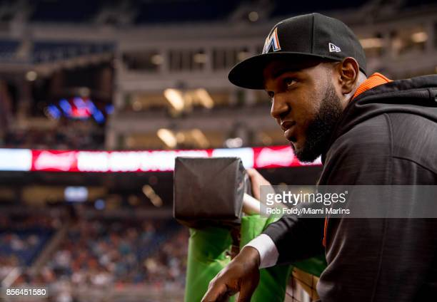 Marcell Ozuna of the Miami Marlins looks on from the dugout during the game against the Atlanta Braves at Marlins Park on September 30 2017 in Miami...