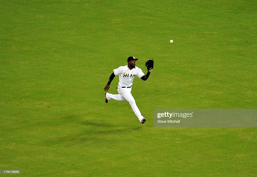 <a gi-track='captionPersonalityLinkClicked' href=/galleries/search?phrase=Marcell+Ozuna&family=editorial&specificpeople=10358366 ng-click='$event.stopPropagation()'>Marcell Ozuna</a> #48 of the Miami Marlins makes a catch during the fourth inning against the Washington Nationals at Marlins Park on July 13, 2013 in Miami, Florida.