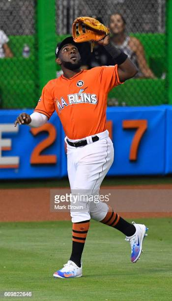 Marcell Ozuna of the Miami Marlins makes a catch in action during the game between the Miami Marlins and the New York Mets at Marlins Park on April...