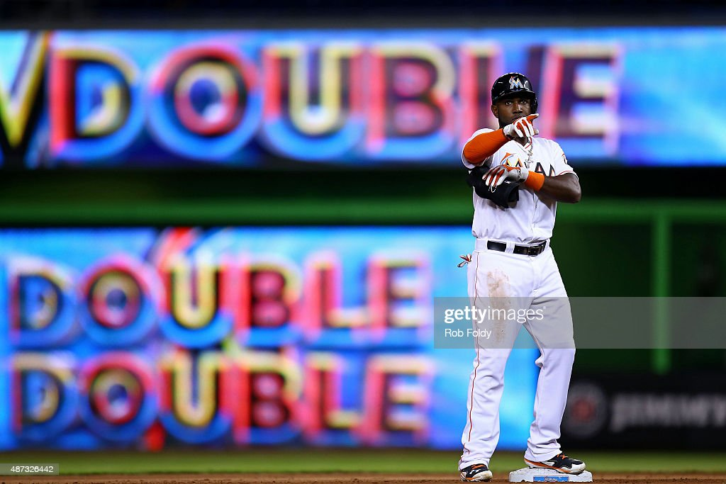 <a gi-track='captionPersonalityLinkClicked' href=/galleries/search?phrase=Marcell+Ozuna&family=editorial&specificpeople=10358366 ng-click='$event.stopPropagation()'>Marcell Ozuna</a> #13 of the Miami Marlins motions to the dugout after hitting a double during the seventh inning of the game against the Milwaukee Brewers at Marlins Park on September 8, 2015 in Miami, Florida.