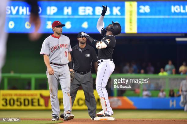 Marcell Ozuna of the Miami Marlins points to the sky after hitting a double in the seventh inning against the Cincinnati Reds at Marlins Park on July...