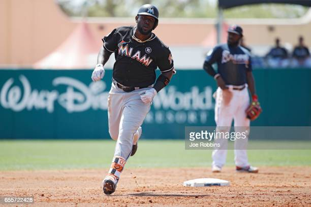 Marcell Ozuna of the Miami Marlins rounds the bases after a solo home run in the second inning of a Grapefruit League spring training game against...