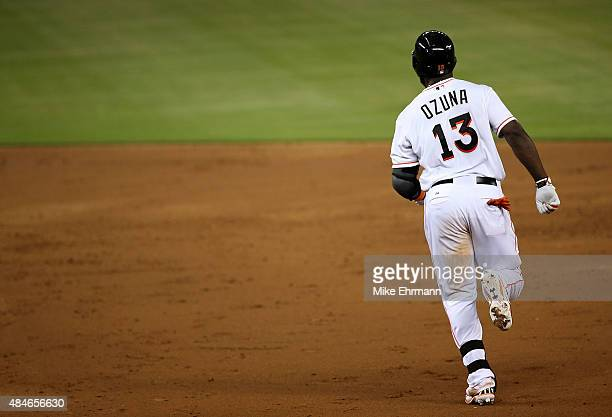 Marcell Ozuna of the Miami Marlins rounds the bases after hitting a two run home run during a game at Marlins Park on August 20 2015 in Miami Florida