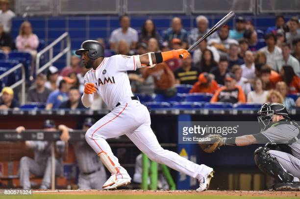 Marcell Ozuna of the Miami Marlins singles in the second inning against the Colorado Rockies at Marlins Park on August 11 2017 in Miami Florida