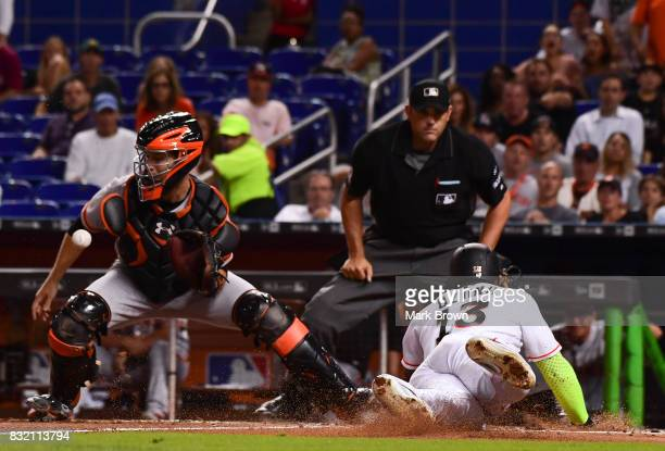 Marcell Ozuna of the Miami Marlins slides into home during the third inning during the game between the Miami Marlins and the San Francisco Giants at...