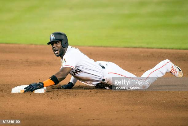 Marcell Ozuna of the Miami Marlins slides into second base during a MLB game against the Washington Nationals at Marlins Park on August 1 2017 in...