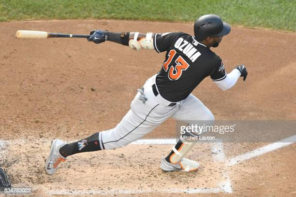 Marcell Ozuna of the Miami Marlins takes a swing during a baseball game against the Washington Nationals at Nationals Park on August 9 2017 in...