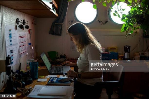 Marcella Kraay a Dutch coordinator for the French NGO 'Doctor Without Borders' works in her office aboard the Aquarius rescue ship on August 14 2017...