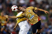 Marcello Fiorentini of the Jets heads the ball in front of Leo Bertos of the Phoenix during the round 15 ALeague match between the Newcastle Jets and...