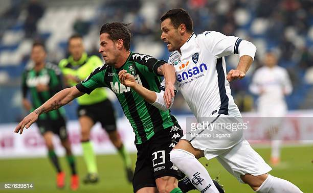 Marcello Gazzola of Sassuolo competes with Manuel Pasqual of Empoli during the Serie A match between US Sassuolo and Empoli FC at Mapei Stadium...