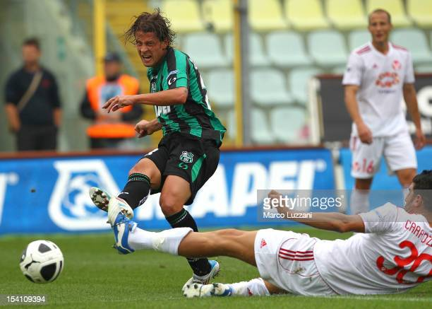 Marcello Gazzola of US Sassuolo Calcio scores the opening goal of the Serie B match between US Sassuolo Calcio and AS Varese at Alberto Braglia...