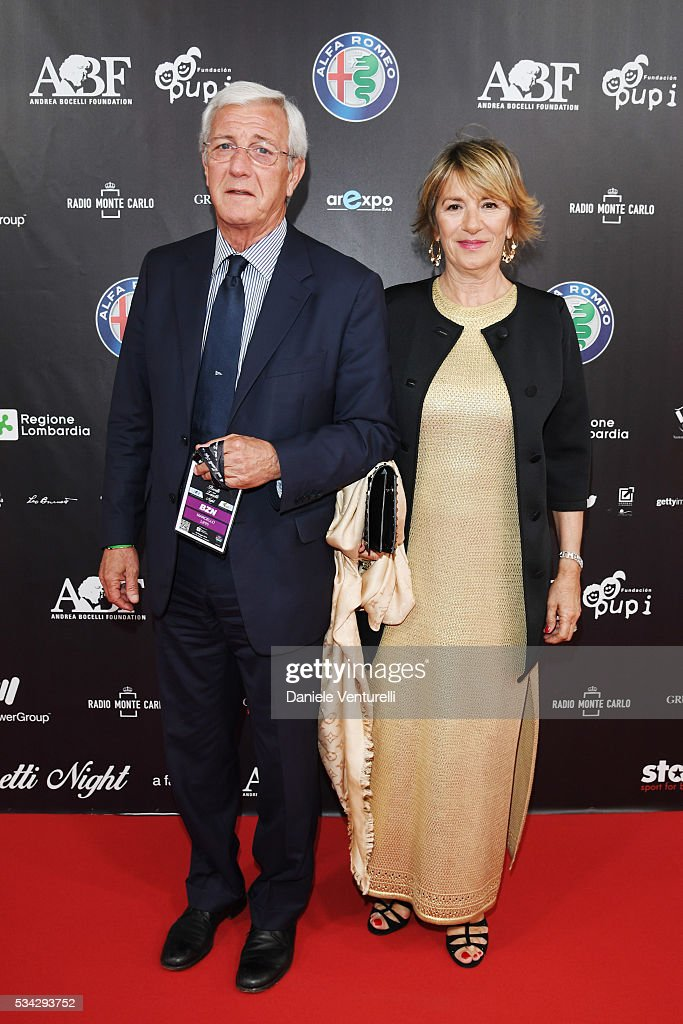 Marcello Lippi and Simonetta Lippi walk the red carpet of Bocelli and Zanetti Night on May 25, 2016 in Rho, Italy.