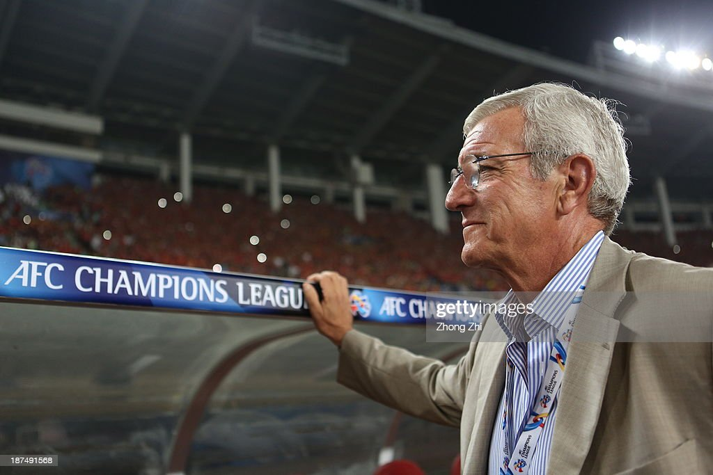 <a gi-track='captionPersonalityLinkClicked' href=/galleries/search?phrase=Marcello+Lippi&family=editorial&specificpeople=535060 ng-click='$event.stopPropagation()'>Marcello Lippi</a>, coach of Guangzhou Evergrande smiles during the AFC Champions League Final 2nd leg between Guangzhou Evergrande and FC Seoul at Tianhe Stadium on November 9, 2013 in Guangzhou, China.