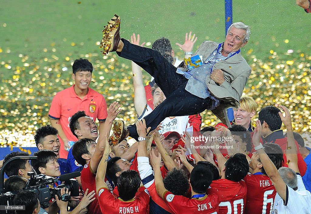 <a gi-track='captionPersonalityLinkClicked' href=/galleries/search?phrase=Marcello+Lippi&family=editorial&specificpeople=535060 ng-click='$event.stopPropagation()'>Marcello Lippi</a>, head coach of Guangzhou Evergrande, is thrown in the air by his players as they celebrate after the AFC Champions League Final 2nd leg match between Guangzhou Evergrande and FC Seoul at Guangzhou Tianhe Sport Center Stadium on November 9, 2013 in Guangzhou, China.