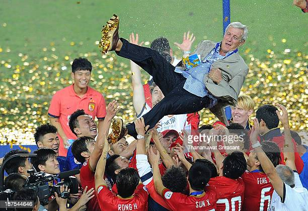 Marcello Lippi head coach of Guangzhou Evergrande is thrown in the air by his players as they celebrate after the AFC Champions League Final 2nd leg...