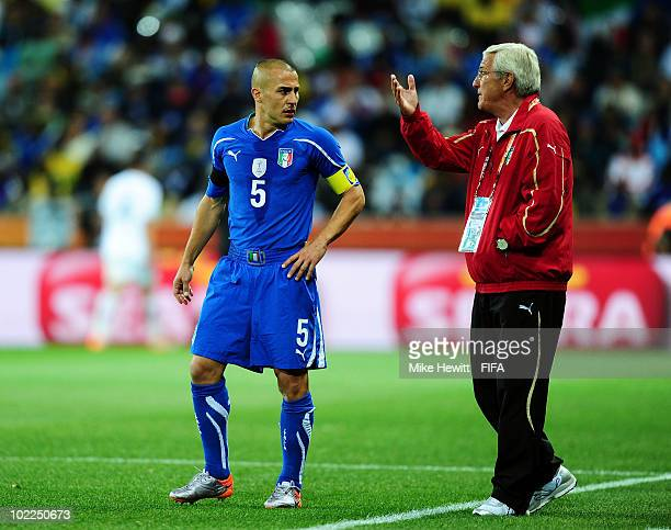 Marcello Lippi head coach of Italy gives instructions to Fabio Cannavaro during the 2010 FIFA World Cup South Africa Group F match between Italy and...