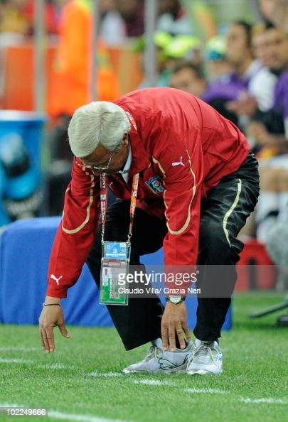 Marcello Lippi head coach of Italy is dejected after his team manage a draw in the 2010 FIFA World Cup South Africa Group F match between Italy and...