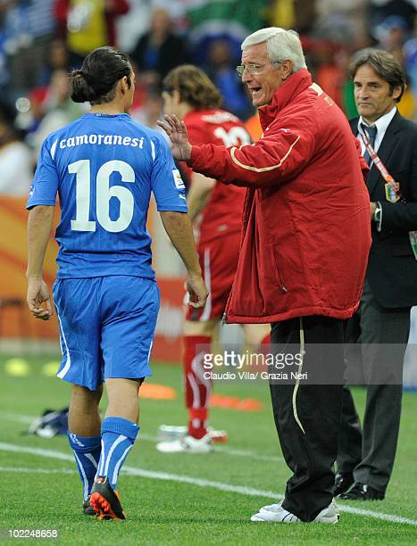 Marcello Lippi head coach of Italy speaks with Mauro Camoranesi of Italy during the 2010 FIFA World Cup South Africa Group F match between Italy and...
