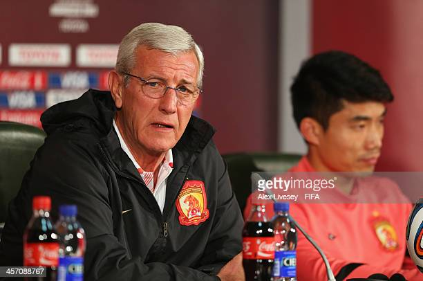 Marcello Lippi the coach of Guangzhou Evergrande FC and Zhi Zheng the captain face the media during a press conference at the Agadir Stadium on...