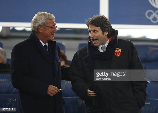 Marcello Lippi the coach of Italy speaks with Giampaolo Montali General Manager of AS Roma on the stands during the Tim Cup between at Roma and...