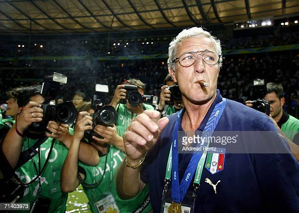Marcello Lippi the coach of smokes a cigar following his team's victory during the FIFA World Cup Germany 2006 Final match between Italy and France...