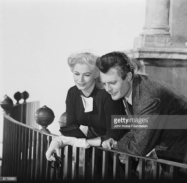 Marcello Mastroianni and Anita Ekberg share a blissful screen moment in 'La Dolce Vita' directed by Federico Fellini