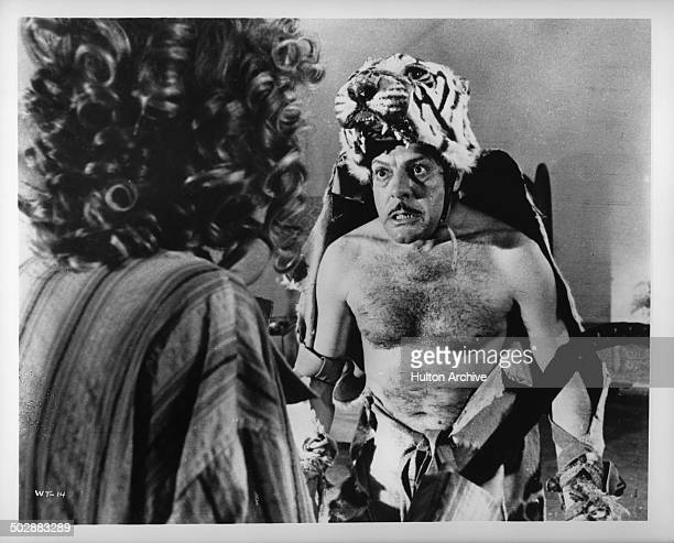 Marcello Mastroianni dresses in a tiger skin in a scene of the movie 'What' circa 1972