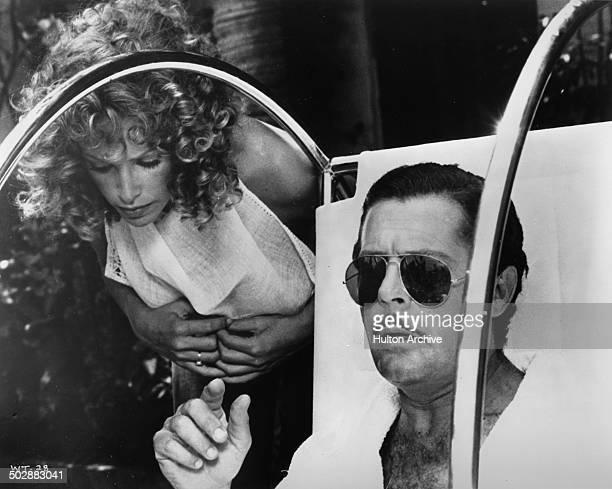 Marcello Mastroianni gives orders to Sydne Rome in a scene of the movie 'What' circa 1972