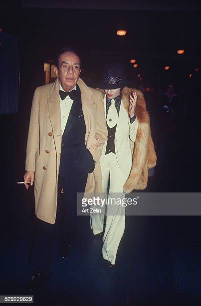 Marcello Mastroianni with a friend walking to a formal event circa 1970 New York
