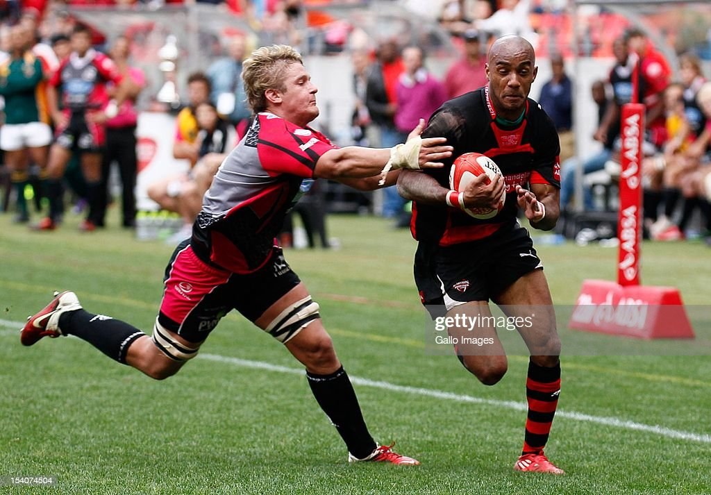 Marcello Sampson (R) of the EP Kings runs with the ball during the Absa Currie Cup First Division final match between Eastern Province Kings and Ford Pumas at Nelson Mandela Bay Stadium on October 13, 2012 in Port Elizabeth, South Africa.