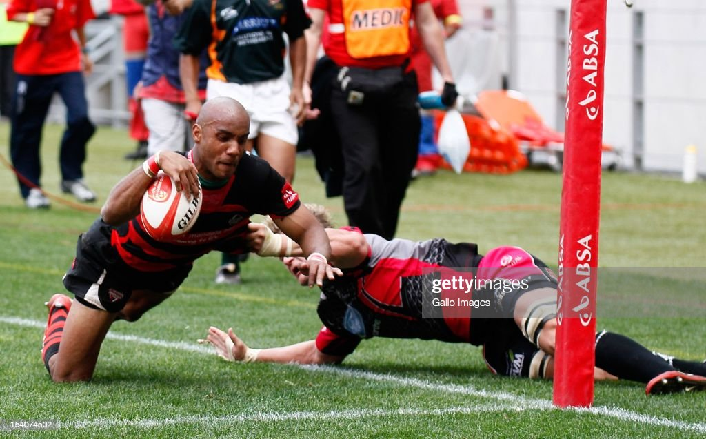 Marcello Sampson (L) of the EP Kings scores a try during the Absa Currie Cup First Division final match between Eastern Province Kings and Ford Pumas at Nelson Mandela Bay Stadium on October 13, 2012 in Port Elizabeth, South Africa.