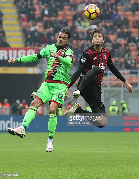 Marcello Trotta Adrian Marius Stoian of FC Crotone competes for the ball with Manuel Locatelli of AC Milan during the Serie A match between AC Milan...