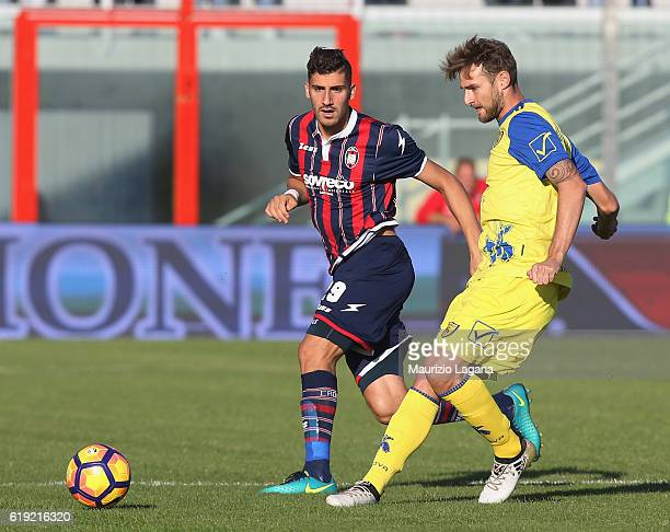 Marcello Trotta competes for the ball with Nicola Rigoni of Chievo during the Serie A match between FC Crotone and AC ChievoVerona at Stadio Comunale...