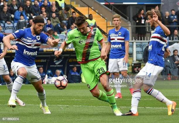 Marcello Trotta is challenge by Matias Silvestre and Bartosz Bereszynski during the Serie A match between UC Sampdoria and FC Crotone at Stadio Luigi...