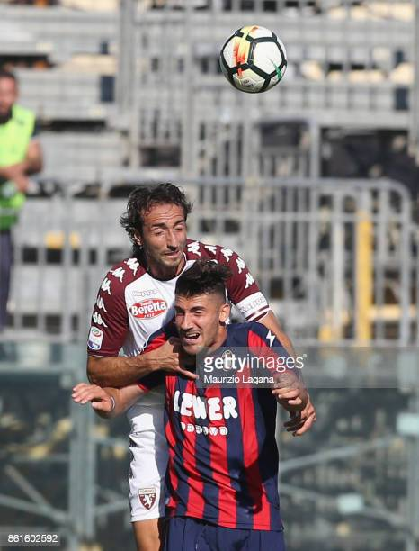 Marcello Trotta of Crotone competes for the ball in air with Emiliano Moretti of Torino during the Serie A match between FC Crotone and Torino FC at...