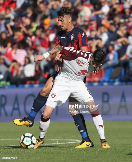 Marcello Trotta of Crotone competes for the ball with Daniele Baselli of Torino during the Serie A match between FC Crotone and Torino FC at Stadio...