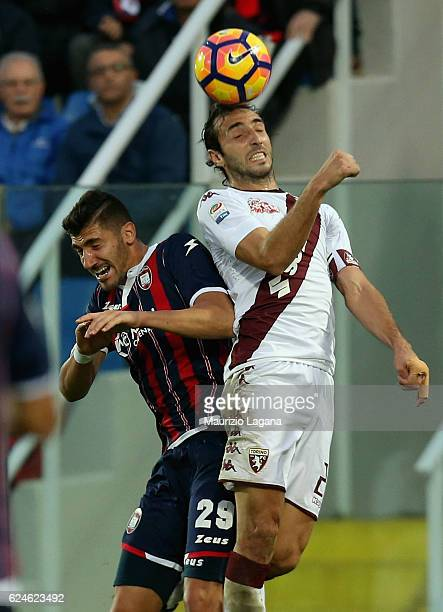 Marcello Trotta of Crotone competes for the ball with Emiiano Moretti of Torino during the Serie A match between FC Crotone and FC Torino at Stadio...