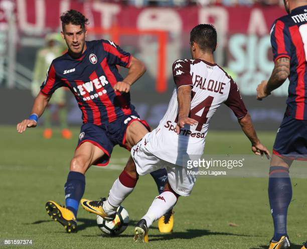 Marcello Trotta of Crotone competes for the ball with Iago Falque of Torino during the Serie A match between FC Crotone and Torino FC at Stadio...
