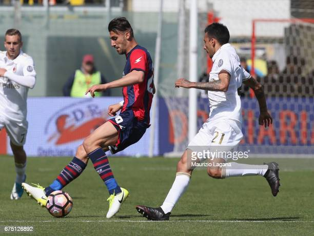 Marcello Trotta of Crotone competes for the ball with Leonel Vangioni of Milan during the Serie A match between FC Crotone and AC Milan at Stadio...