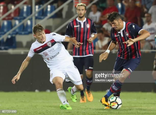 Marcello Trotta of Crotone competes for the ball with Nicolò Barella of Cagliari during the PreSeason Friendly match between FC Crotone and Cagliari...